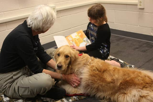 Kids of all ages can build confidence reading out loud by reading to therapy dogs at the Wilton Library this Saturday/
