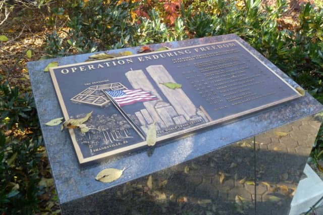 One of the plaques at the Scarsdale American Legion Memorial Garden pays tribute to the victims of the terrorist attacks of Sept. 1, 2001.