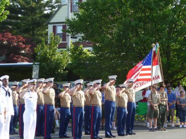 U.S. Navy and Marines salute for the Pledge of Allegiance at a previous year's Mamaroneck Memorial Day ceremony.