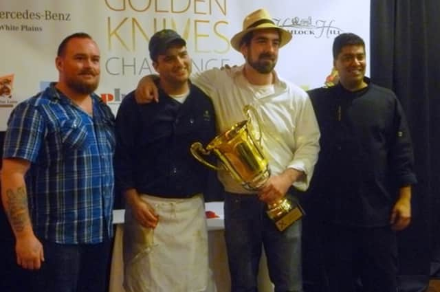 Chef Carl Van Dekker, second from right, takes photos with his fellow competitors after winning the Golden Knives Challenge.