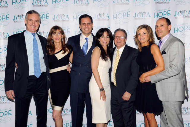Stephen (third from left) and Lory Gilberg (center) were honored at the Jewish Child Care Association's annual benefit.