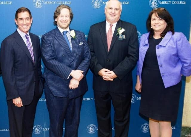 New York State Senator Jeffrey D. Klein, Douglas D. Gollan, Michael Robinson, and Dr. Kimberly Cline at the Mercy College Trustees' Scholarship Dinner, which raised more than $400,000 for student scholarships.