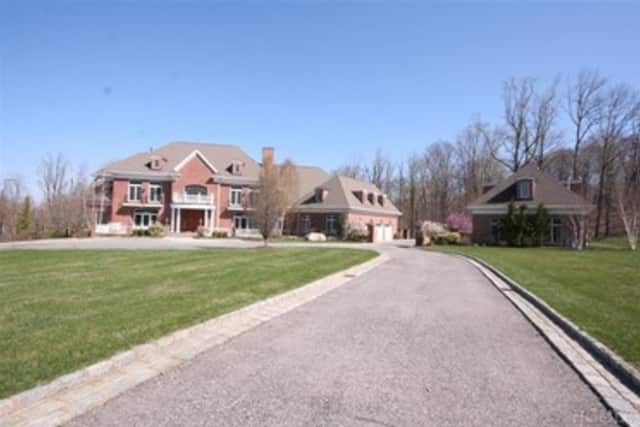 A five-bedroom home on Hollow Ridge Road is listed at $4,999,999.