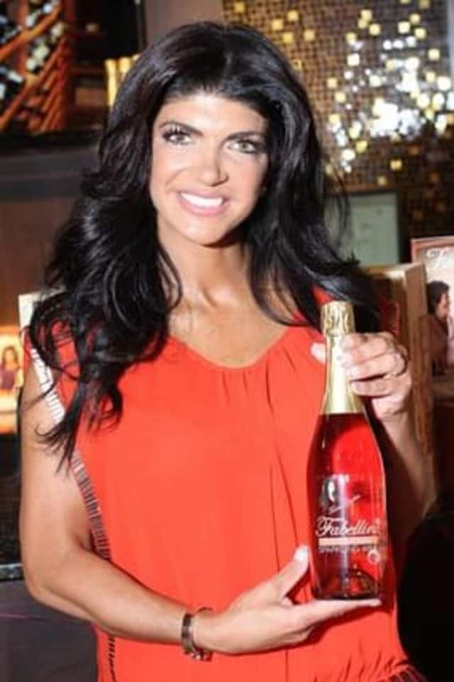 """Midway Wine and Liquors will host """"Teresa Giudice"""" of Bravo's Hit Series """"The Real Housewives of New Jersey"""" June 8 for a signing."""