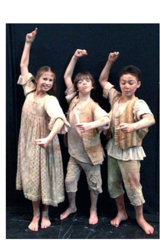 JKO students (from left) Olivia Scott, Justin Souriau-Levine and Pound Ridge's Lenin Hibler perform in Don Quixote.