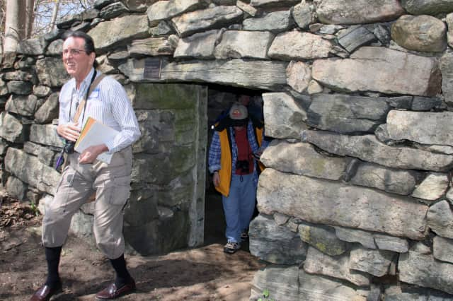 Archeological researcher David Johnson (left) conducted a tour of North Salem's stone chambers and cairns.