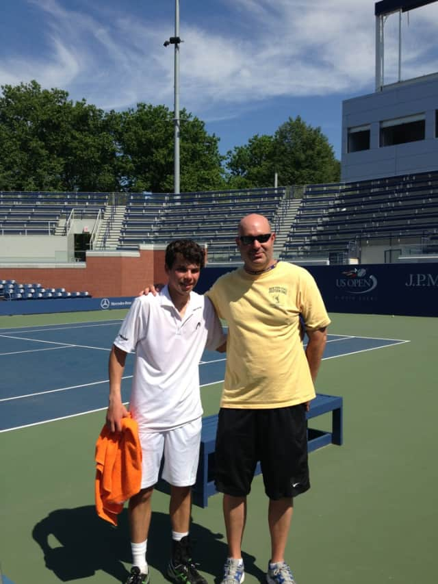 Dobbs Ferry High School's Shawn Hadavi and his tennis coach Eric Bartell following Hadavi's victory to win the state singles title.