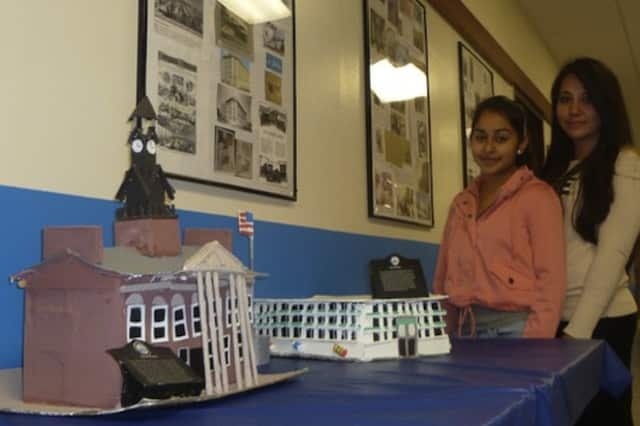 Port Chester Middle School students show off a model they made for last year's National Arts in the School Day. This year the celebration will be held Thursday across the district.