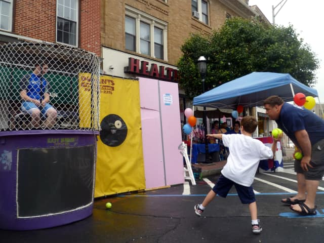 Six-year-old Charlie Carpenter takes aim at the dunk tank at last year's Ossining Village Fair.
