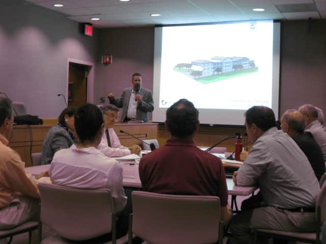 Conifer architect Steve Schoch presented the latest affordable housing concept to two New Castle boards Tuesday night.