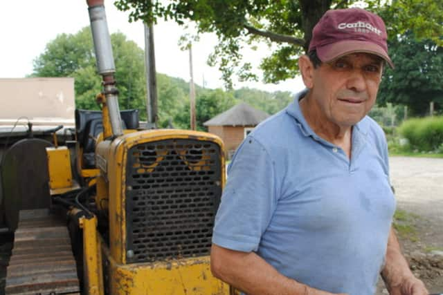 Farmer John DeMaria at Hemlock Hill Farm in Cortlandt Manor. Several Westchester businesses are helping raise funds for the farm that was destroyed by a fire in April.