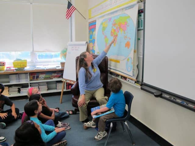 Maureeen Moser explains the derivation of words to Eastchester fourth graders.