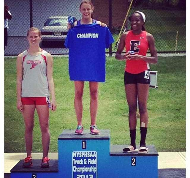 North Salem High School senior Noemi Bechu (c.) took first place in the 200m event at the New York State meet.