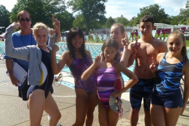 Coach Don Wemer, back left, and his Hastings Pool swim team at last summer's Westchester Swim Conference meet.