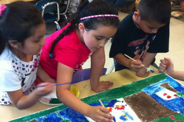 Students at Edison School paint tiles for the school's version of the Sistine Chapel as part of Port Chester's National Art in the Schools Day.