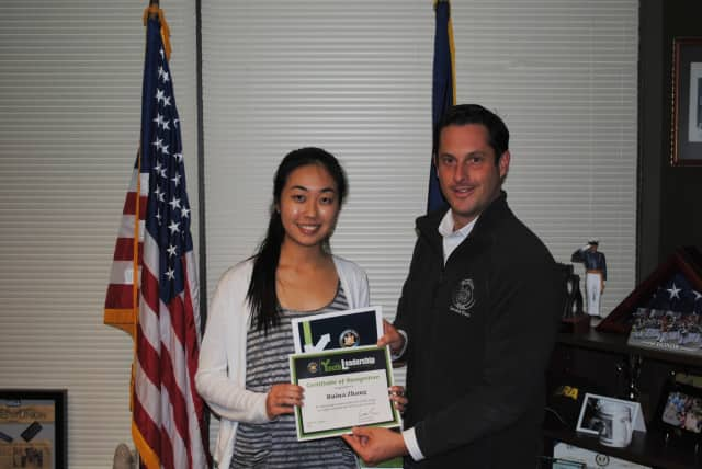 Somers High School Salutatorian Ruina Zhang receives the New York State Youth Leadership Recognition Award from state Sen. Greg Ball.