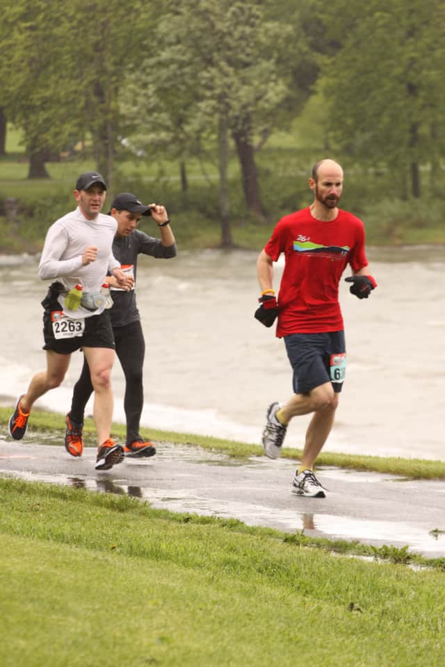 Stamford's Bill Brucker (in white), the communications director of Greenwich-based Family Centers, runs in the KeyBank Vermont City Marathon.