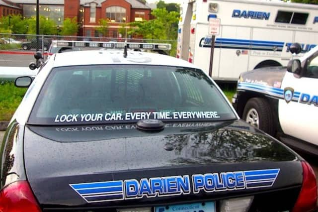 Darien Police say a Norwalk woman who backed into a light pole with a child in her backseat was driving under the influence.