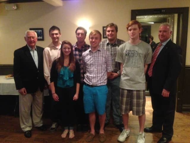 Six of the eight Mary Denning Scholarship recipients pose with the late Denning's husband and son in Eastchester.