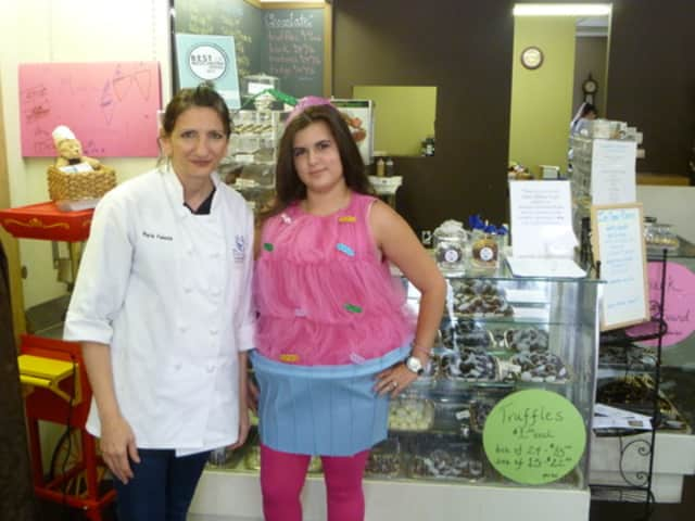 The owner of Chocolations Maria Velente (left) had her employee Yennifer Bayarae dress up like a cupcake for the store's one year anniversary.