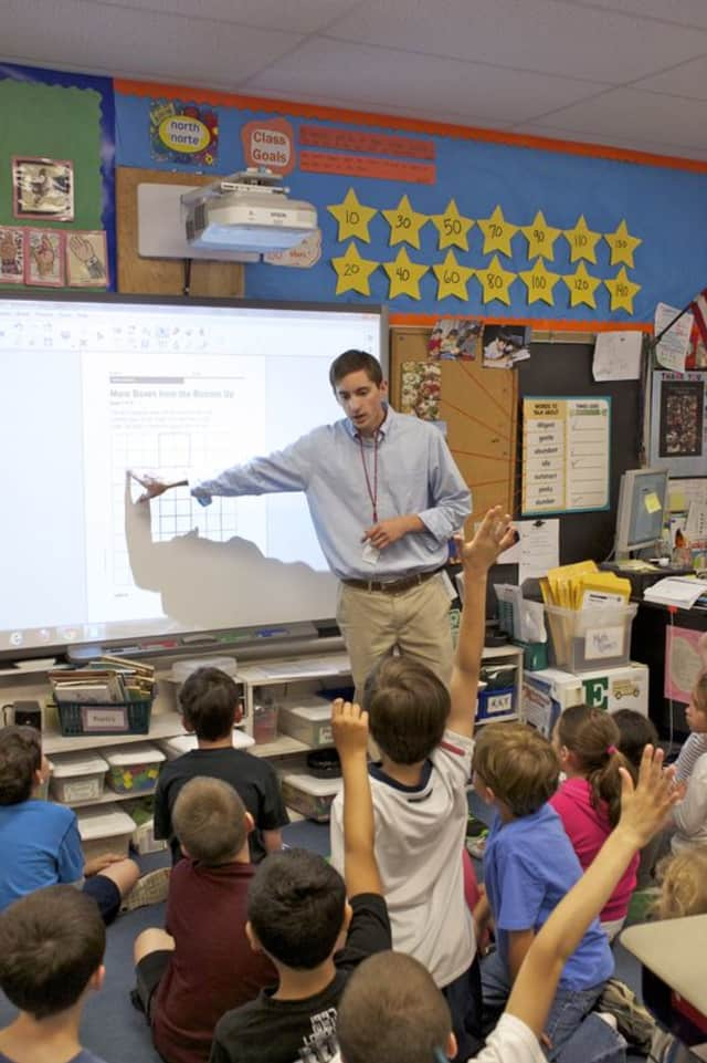 New Canaan High School's Greg Wagner got to spend time teaching third-graders at East School as part of the Senior Internship Program.
