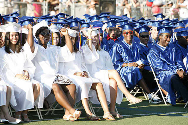 Members of the Class of 2010 at Brien McMahon High School in Norwalk enjoying their graduation. This year's class of current seniors at BMHS graduate Wednesday.