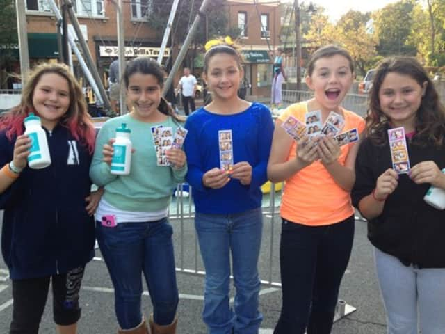 Alanna Alvarez, 10, Gianna Strazza,10, Haylee Wootten, 12, Molly Phelan, 11, and Taylor Macri, 10, all Ardsley residents, showed off their photo booth pictures at last year's Ardsley Day.