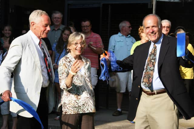 (From left) Peter Kamenstein, Page Dickey and George Bovino cut the ribbon at the North Salem Community Garden.