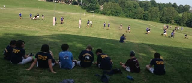 Pelham Youth Rugby players relax in Pennsylvania on the final day of the season.