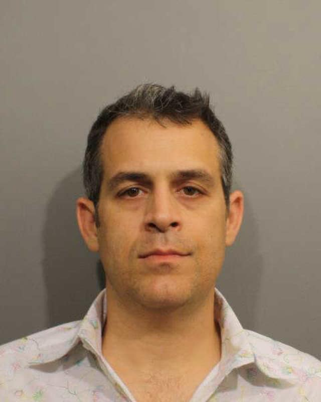 Wilton restaurant owner Matthew Criscuolo Jr. was charged with discharging without a permit.