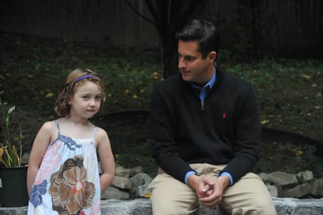 Yorktown resident Hannah Devane, 8, stands with State Sen. Greg Ball (R,C,I-Patterson) who helped sponsor a proposed law inspired by Hannah.