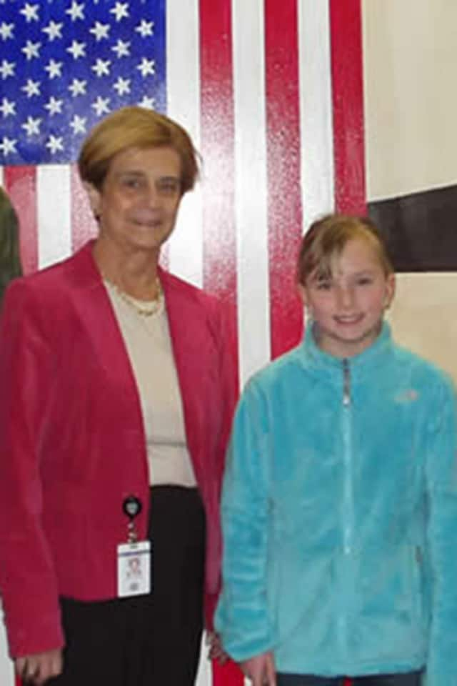 Virginia Rico, principal of Wilton's Cider Mill School, is pictured with a student in 2011. Rico died Wednesday.