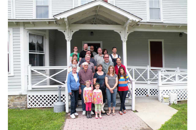 The Gregory-Lobdell family posed on the steps of North Salem's Lobdell House to kick off off its 2013 reunion.