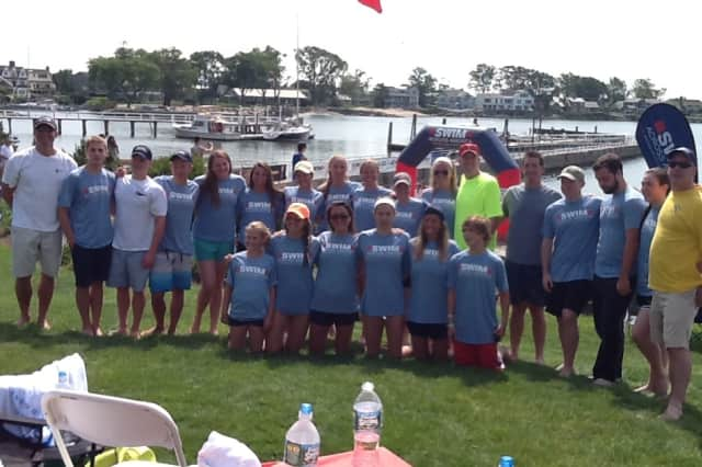 Members of the Wilton Wahoos raised more than $27,000 in the recent Swim Across America.