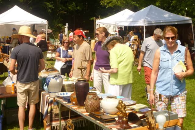 Attendees check out the merchandise at Antiques in the Church Yard in South Salem.