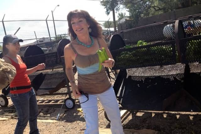 Barbara Nevins shows off some New Mexico Green chilies. Her Ridgefield restaurant will host the seventh annual Sunset 5K road race next month to benefit the Sunrise Cottage.