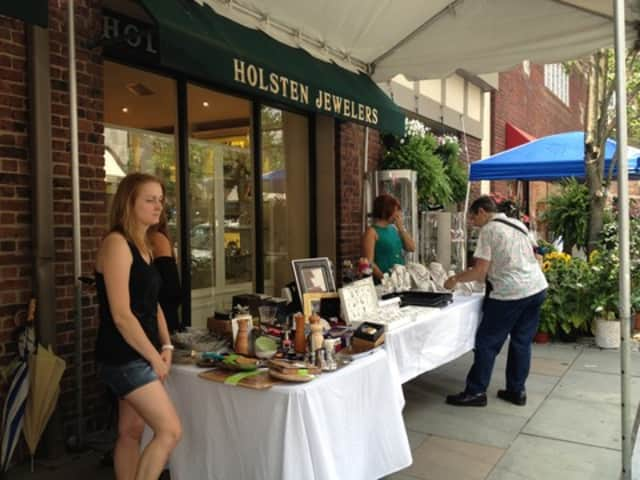 Scarsdale shoppers look through various goods and jewelry outside Holsten Jewelers at last year's Sidewalk Sale.