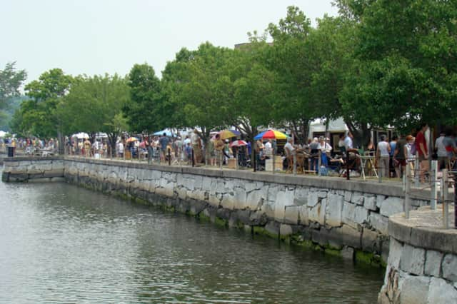 Exhibit booths line the Saugatuck River at Parker-Harding Plaza in downtown Westport during a past year's Westport Fine Arts Festival.