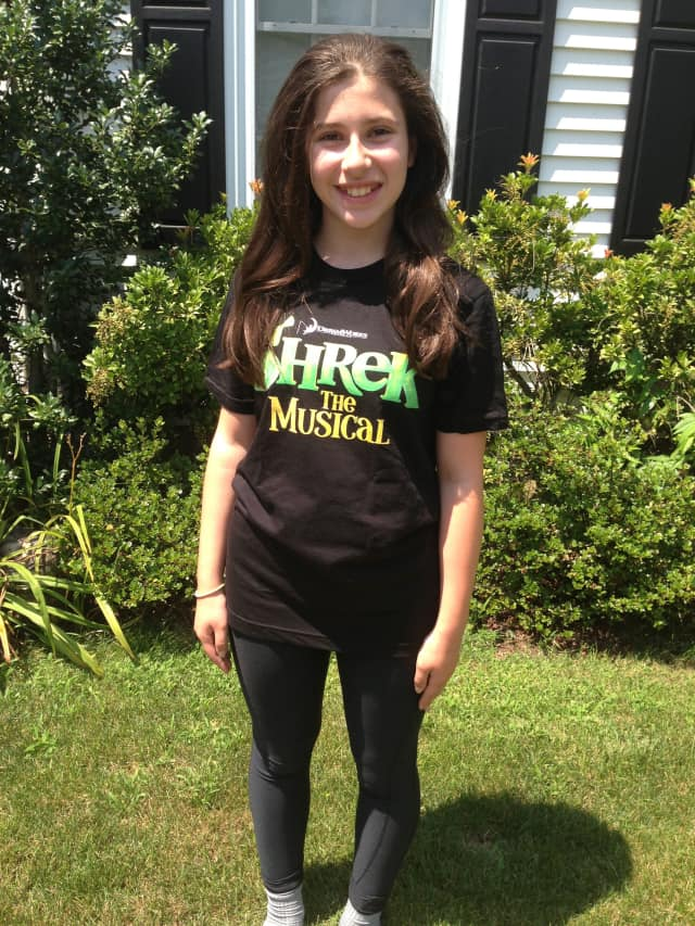 "Isabella Salant of New Canaan wears her ""Shrek The Musical"" t-shirt, a production she will be acting in along with two others from town."