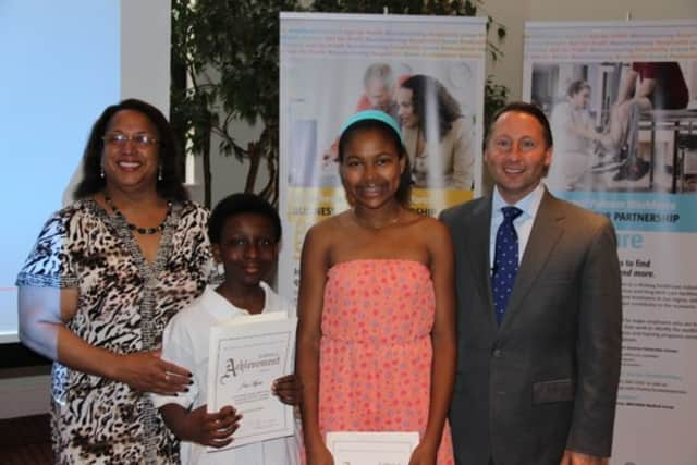Westchester County Executive Rob Astorino with the winners of the Astorino Challenge in Education, J'air Myree and Hannah Zamor.