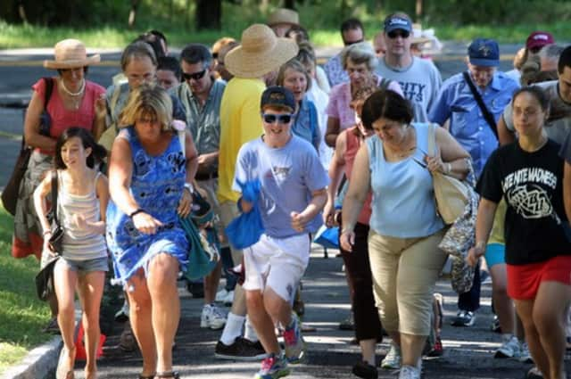 People from all over Westchester and neighboring communities run up the driveway in a previous annual auction of St. James Episcopal Church's in North Salem.