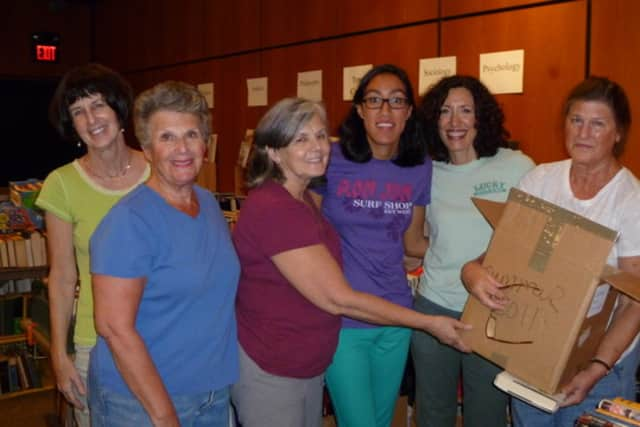 Kathy Steves, third from left, and volunteers get ready for the annual Scarsdale Public Library Book Sale.