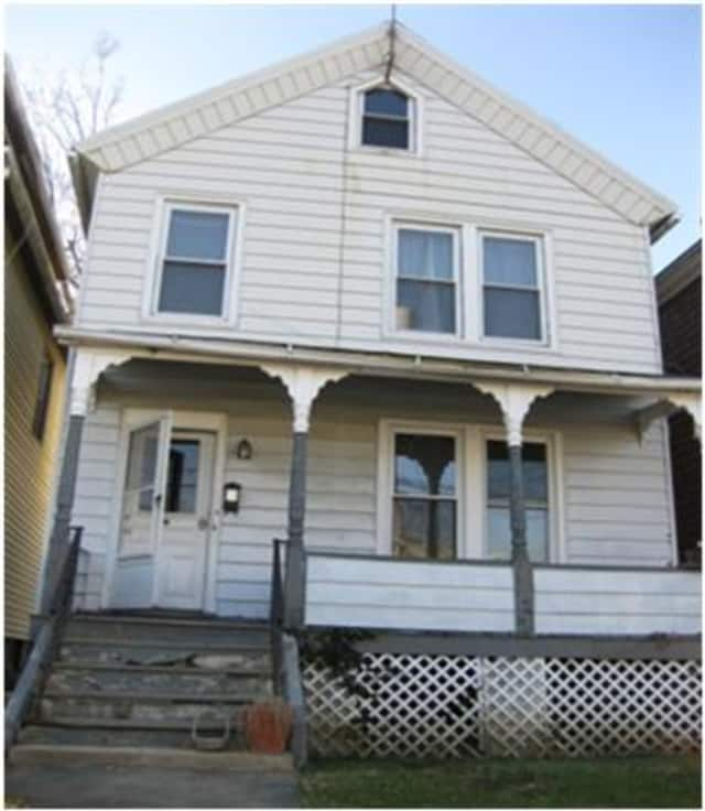 This house at 94 State St., Ossining, will be available at the auction.