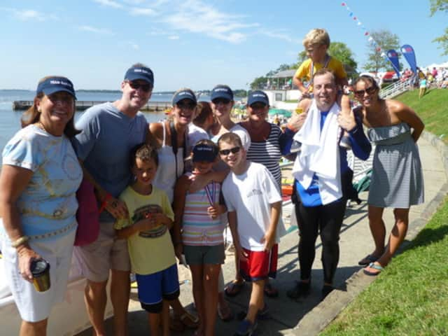 'Team Sarah' -- Haller and Glennon families -- celebrate another Swim Across America after the 2011 event
