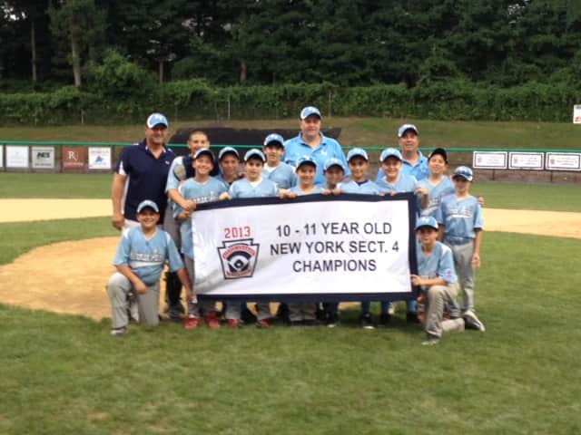 The Sherman Park Little League team celebrates its Section 4 championship title. See story for IDs.