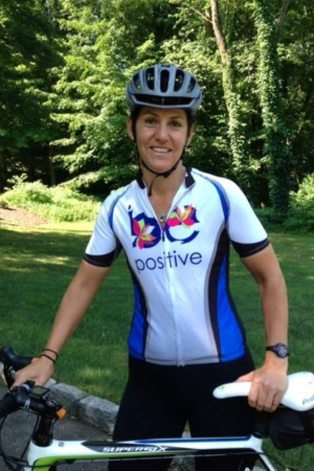 Wilton's Jenn Lewis, a cancer survivor, rode in the Connecticut Challenge Saturday in honor of two friends.