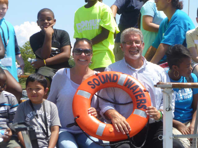 Jeanne Melino, of the Steven and Alexandra Cohen Foundation, and Michael Duggan, executive director of Domus, are joined on the SoundWaters Schooner by about 25 campers from Domus on Monday afternoon.