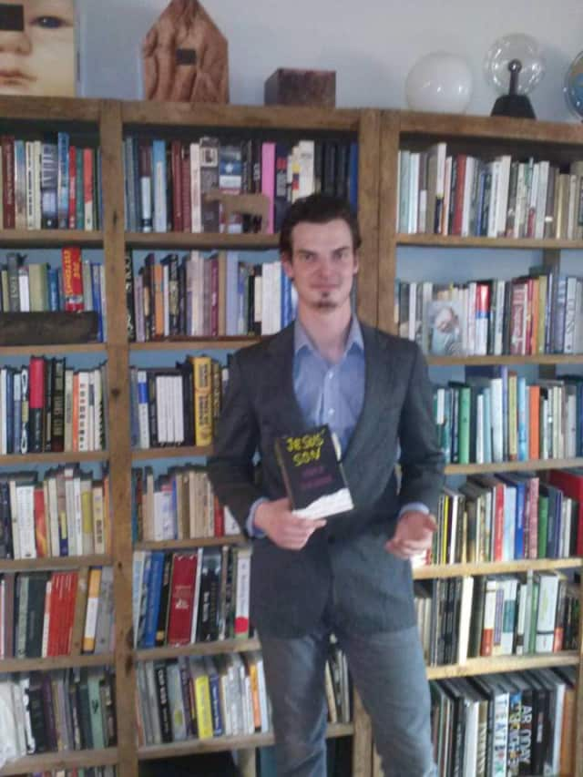 Hastings online book store owner Jaek Shaps and some of his stock of current and rare books.