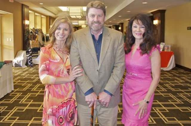 Lisa Gerrol (right) poses with Greg and Alison Jacobson while at the 2013 Fairfield County Women Against MS luncheon in May.