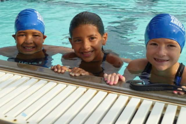 From left, young swimmers like Natalia Benejam, Alexa Benejam and Eva Cantalapiedra have participated in Swim Across America at the Lake Isle Club in Eastchester.
